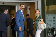 Princess Letizia styled her casual outfit with a luxe python tote when she visited King Juan Carlos I in the hospital.
