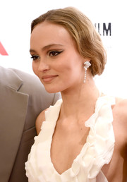 Lily-Rose Depp styled her hair into a loose updo for the BFI London Film Festival premiere of 'The King.'