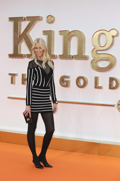 Claudia Schiffer made an appearance at the world premiere of 'Kingsman: The Golden Circle' wearing a black-and-white striped sweater dress.