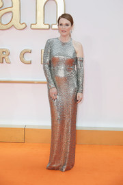 Julianne Moore went for futuristic glamour in an asymmetrical silver sequin gown by Tom Ford at the world premiere of 'Kingsman: The Golden Circle.'