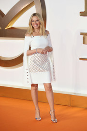 Kylie Minogue perfected her look with a pair of silver ankle-strap heels.