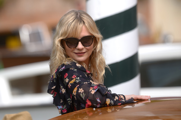 Kirsten Dunst Cateye Sunglasses [photo,eyewear,hair,sunglasses,blond,glasses,vision care,street fashion,sitting,brown hair,long hair,taxi-boat,kirsten dunst,filippo monteforte,celebrity sightings,excelsior hotel,venice lido,afp,74th venice film festival]
