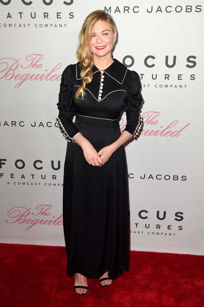 Kirsten Dunst Shirtdress [the beguiled,clothing,dress,carpet,red carpet,hairstyle,fashion,flooring,formal wear,little black dress,premiere,kirsten dunst,new york city,the metrograph,new york premiere]