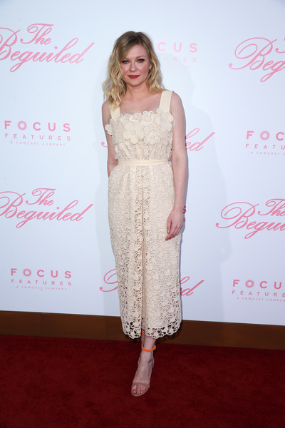 Kirsten Dunst Strappy Sandals [the beguiled,clothing,red carpet,dress,carpet,pink,premiere,fashion,hairstyle,flooring,shoulder,arrivals,kirsten dunst,los angeles,california,focus features,directors guild of america,premiere,premiere]