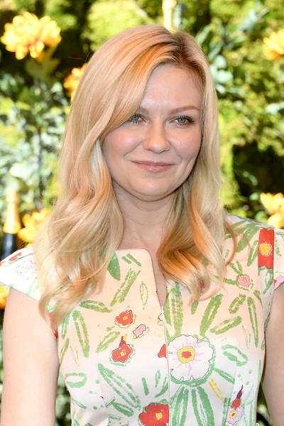 Kirsten Dunst Long Wavy Cut [hair,face,blond,hairstyle,beauty,yellow,fashion,lip,botany,brown hair,arrivals,kirsten dunst,los angeles,pacific palisades,california,will rogers state historic park,veuve clicquot polo classic]