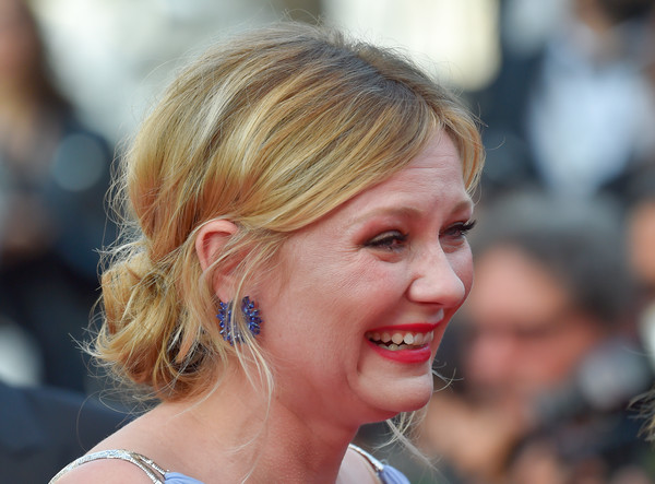 Kirsten Dunst Messy Updo [the beguiled,the beguiled red carpet arrivals,photo,hair,face,hairstyle,blond,chin,beauty,eyebrow,lip,chignon,ear,kirsten dunst,us,cannes,france,cannes film festival,screening,edition]