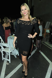 Stacy Keibler teamed her black knit dress with black patent pumps.