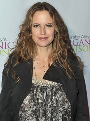 Kelly Preston styled her long locks in long waves at the Organic Liaison store opening.