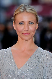 'Knight and Day' star Cameron Diaz attended the film's UK premiere wearing 18k yellow gold spike stud earrings.