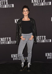 Shenae Grimes topped off her outfit with a black leather biker jacket.