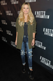Olivia Holt layered a fatigue jacket over a gray shirt for the Knott's Scary Farm Black Carpet event.