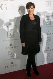 Kris Jenner attended the Legacy International announcement party wearing a black coat with a tasseled hem.
