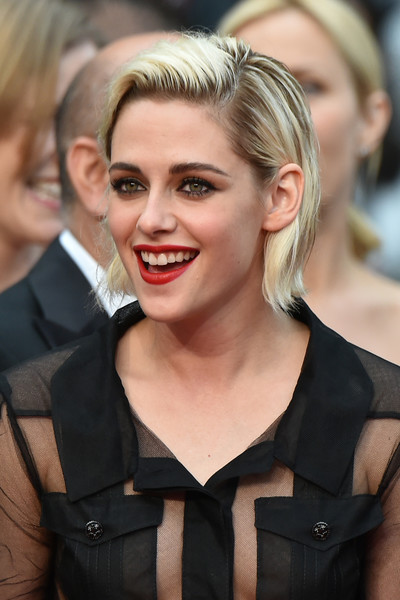 Kristen Stewart Red Lipstick [film,hair,face,blond,hairstyle,facial expression,eyebrow,chin,lip,beauty,skin,kristen stewart,us,cannes,france,red carpet arrivals,cafe society opening gala,cannes film festival,screening,opening ceremony]