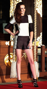 Kristen Stewart looked boyish yet sexy in this mod checkered romper at the 'Breaking Dawn Part 2' photocall in Japan.