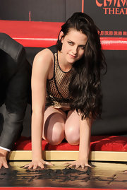 Kristen Stewart wore her luxurious locks long and wavy at her hand and footprint ceremony at Grauman's Chinese Theatre.