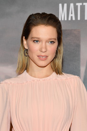 Lea Seydoux looked edgy with her brushed-back hairstyle at the Paris premiere of 'Kursk.'