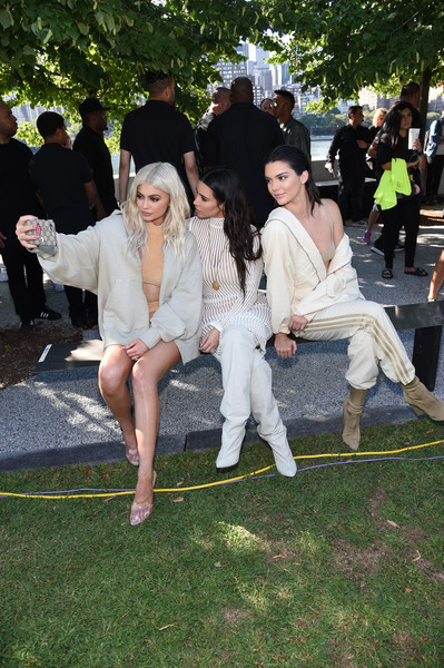 Kylie Jenner Hoodie [season,event,grass,lawn,fun,ceremony,crowd,leisure,arrivals,kendall jenner,kylie jenner,kim kardashian,kanye west yeezy,front row,new york city,fashion show]