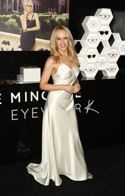 Kylie Minogue gave us bride vibes with this white silk slip dress during the launch of her eyewear collection.