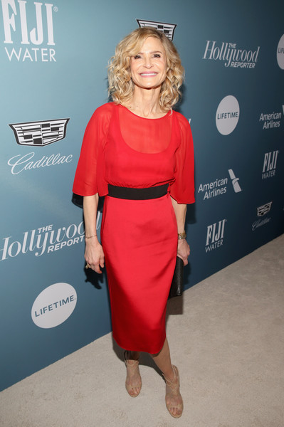 Kyra Sedgwick Strappy Sandals [the hollywood reporter,clothing,dress,red,shoulder,cocktail dress,carpet,fashion,premiere,joint,footwear,power 100 women in entertainment - red carpet,kyra sedgwick,california,los angeles,hollywood reporter,milk studios]
