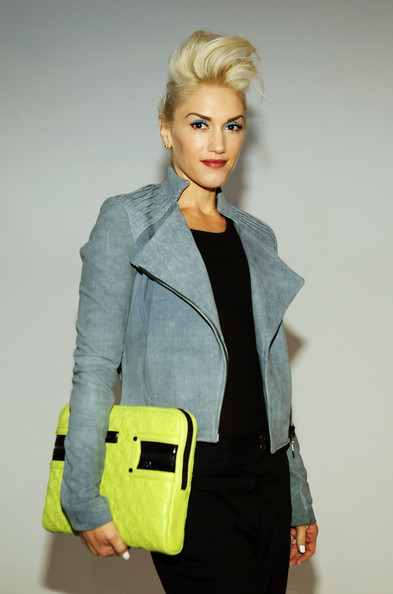 Gwen carried a neon yellow leather case for the for the L.A.M.B. fashion show.