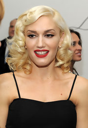 Gwen Stefani achieves a retro look with cat eyes. For a similar look, stick to nude eye shadow and line the eye with liquid liner extending the corners upwards.