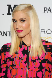 Gwen Stefani traded in her signature red pout for an equally bold pink.