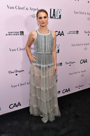 Natalie Portman bared some skin in a sheer gray gown with a black bodysuit underneath at the L.A. Dance Project Gala.