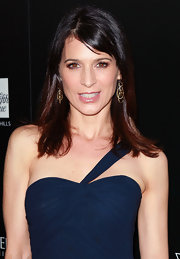 Perrey Reeves attended the LA Gay and Lesbian Center benefit for Homeless Youth Services wearing 18-carat yellow gold pave diamond mobile earrings.