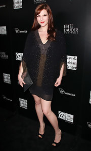 Sara Rue topped off her embellished frock with classic black peep-toe kicks.