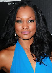 Garcelle Beauvais wore a shimmery shade of jade green eyeshadow while attending a benefit for Homeless Youth Services.