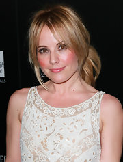 Emma Caulfield wore her hair in a sweet side ponytail with soft bangs and face-framing strands at a benefit for Homeless Youth Services.