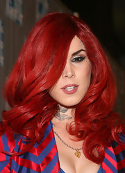 Kat Von D showed off her fiery red hair while hitting the carpet at an L.A. event. Her red hair was a little distracting when paired with a red and blue striped suit.