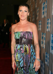 Pink accessorized her look with a printed, oversized leather belt.