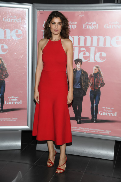 Laetitia Casta complemented her dress with strappy red heels.