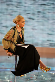 Simona Ventura wore sky-high gold evening sandals with her gown and chain jacket for a totally glamorous look.