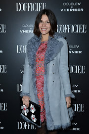 Margherita Missoni looked very cosmopolitan at the L'Officiel dinner in a fur-trimmed blue suede coat layered over a cocktail dress.