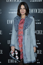 Margherita Missoni accessorized with a very feminine satin clutch featuring floral appliques when she attended the L'Officiel dinner.