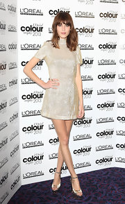 Alexa Chung look stylish as ever in this light gold beaded mini dress.