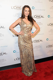 Andie MacDowell shined in a gold sequined gown at the L'Oreal Ovarian Cancer Research benefit.