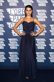 Isabeli Fontana chose an ultra-girly spaghetti-strap ruffle gown by Saint Laurent for her L'Oreal Paris Blue Obsession party look.