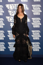 Sticking to her usual black, Carine Roitfeld chose a lace-and-ruffle-festooned lace-up gown for the L'Oreal Paris Blue Obsession party.