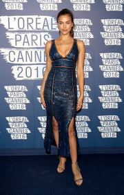Irina Shayk cut a curvy silhouette in this Emilio Pucci form-fitting sequin dress with a low neckline and double slits during the L'Oreal Paris Blue Obsession party.