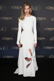 Karlie Kloss styled her cute dress with a mirrored clutch.