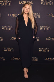 Blake Lively kept it understated yet chic in a sheer-sleeve black tuxedo dress by Lanvin at the L'Oreal Paris Women of Worth celebration.