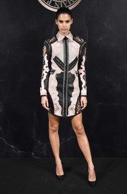 Sara Sampaio attended the L'Oreal x Balmain party wearing a collared black and baby-pink leather dress.