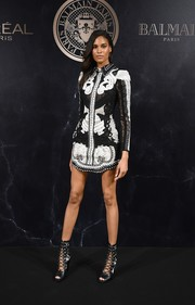 Cindy Bruna hit the L'Oreal x Balmain party looking fierce in an embroidered and studded mini dress.