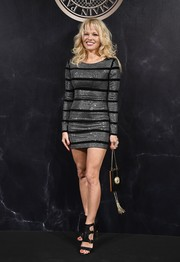 Pamela Anderson flaunted her ageless figure in a body-con chainmail mini dress at the L'Oreal x Balmain party.