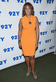 Gayle King styled her plain dress with a pair of printed pumps.