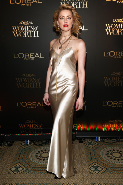 Amber Heard looked sensual in a champagne satin slip gown by Adriana Iglesias at the 2018 L'Oréal Paris Women of Worth celebration.