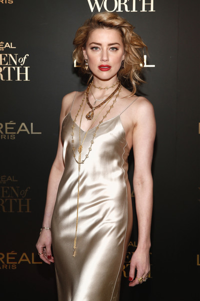 Amber Heard styled her satin dress with layers of gold necklaces for the 2018 L'Oréal Paris Women of Worth celebration.